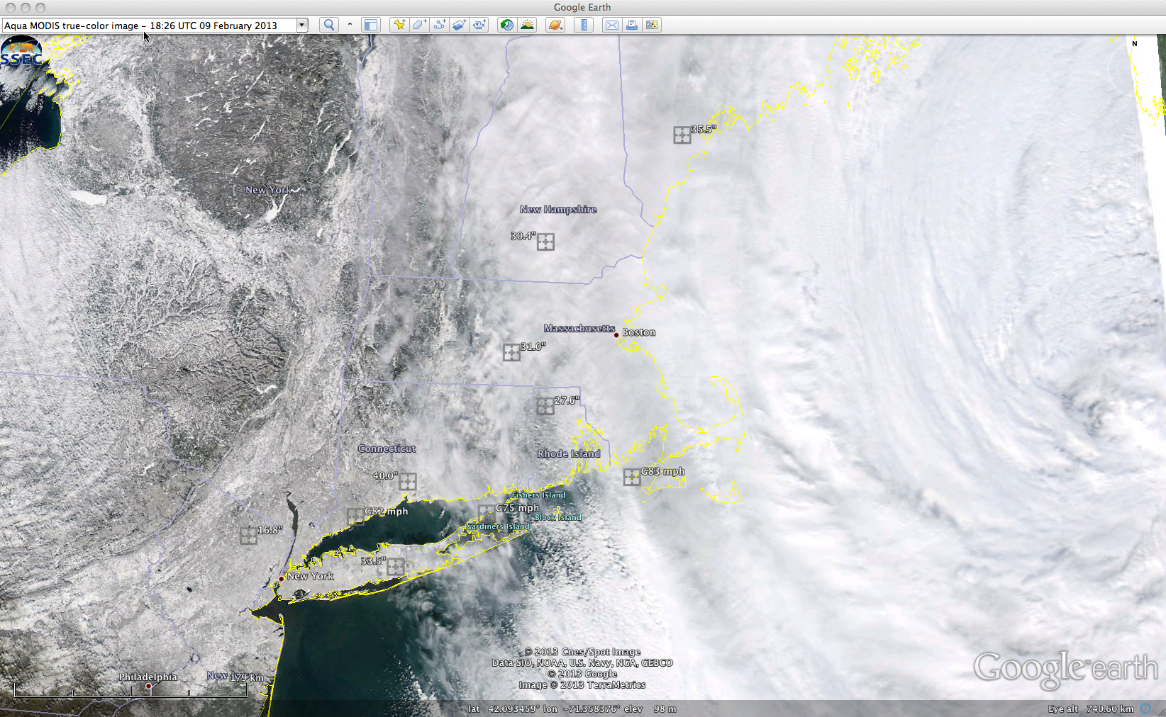 MODIS true-color Red/Green/Blue (RGB) image with maximum storm total snowfall amounts and peak wind gusts