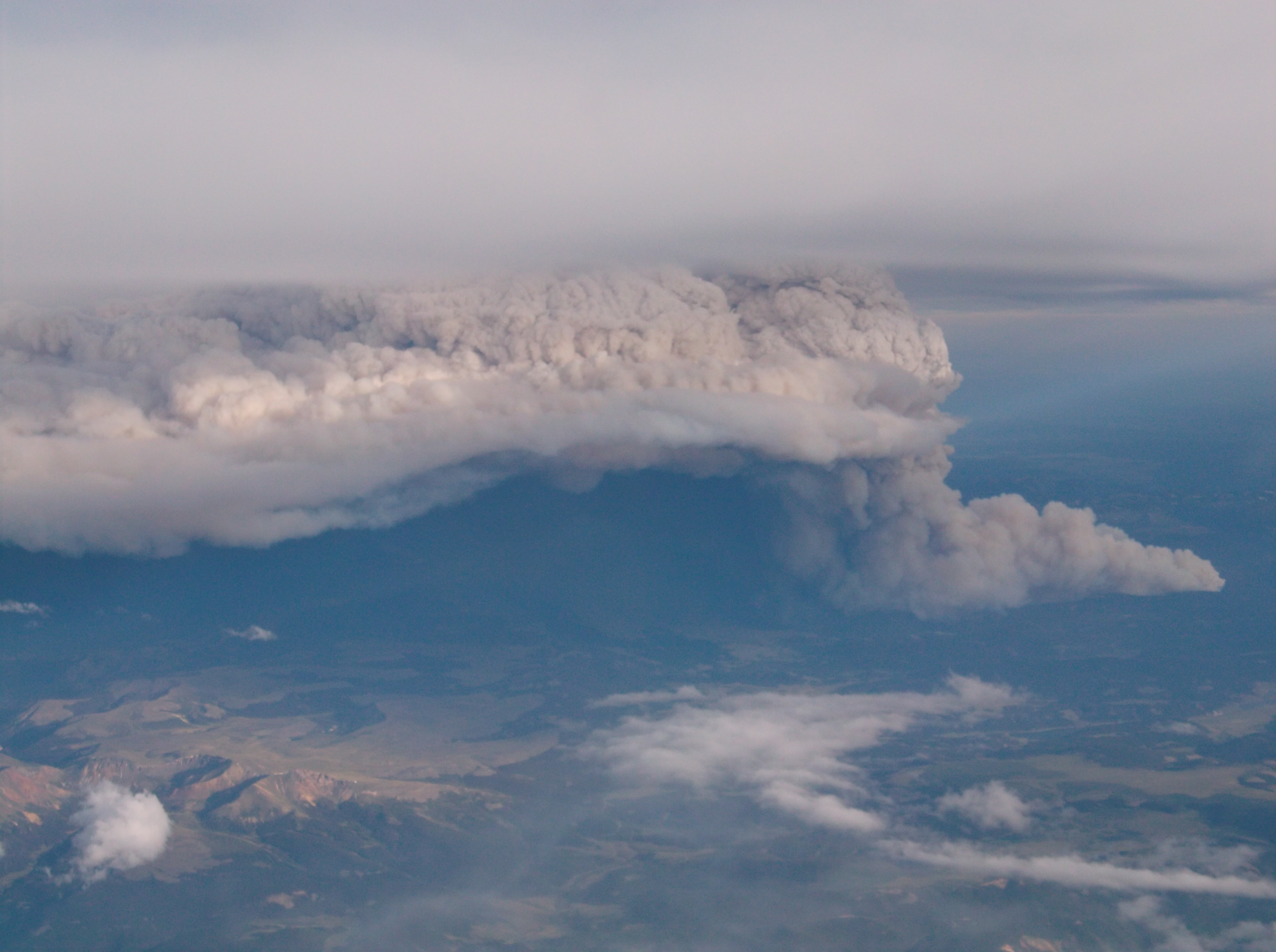 Aerial view of pyrocumulonimbus cloud associated with the West Fork Fire Complex